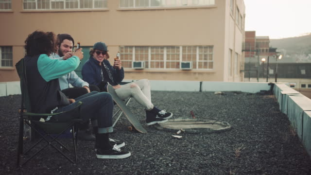 Guys hanging out on rooftop