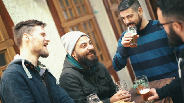 guys having beer at a pub. - male friendship stock videos & royalty-free footage