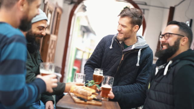 guys having beer at a pub. - moustache stock videos & royalty-free footage