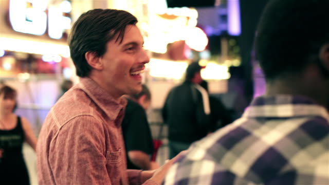 Guys rock out to live music and high-five in downtown Las Vegas