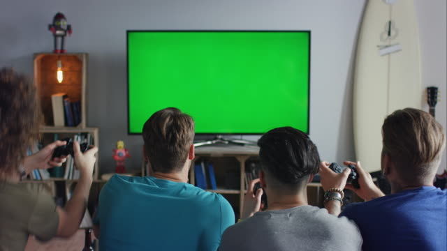 guys sitting on couch playing video games - gamepad stock videos & royalty-free footage