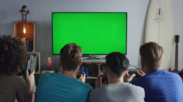 guys sitting on couch playing video games - organized group stock videos & royalty-free footage