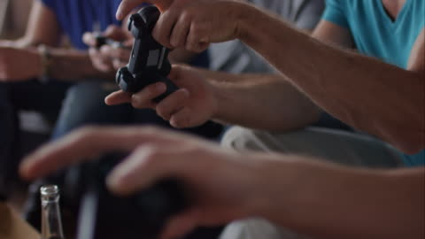 guys sitting on couch playing video games - control stock videos & royalty-free footage