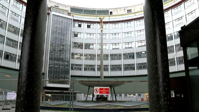 vídeos y material grabado en eventos de stock de gvs bbc television centre before demolition starts; banner 'television centre' / gvs demoliton equipment int empty reception area / ceiling fan ext... - red nose day