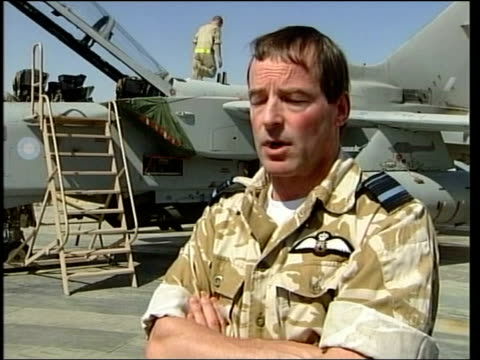 gvs british raf chinook helicopters taxiing on runway at military base la gv british raf tornado with 'aircaft armed danger' sign beside ms tornado... - civilperson bildbanksvideor och videomaterial från bakom kulisserna