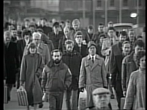 pull focus gvs b/w commuters along across bridge - prosecution stock videos & royalty-free footage