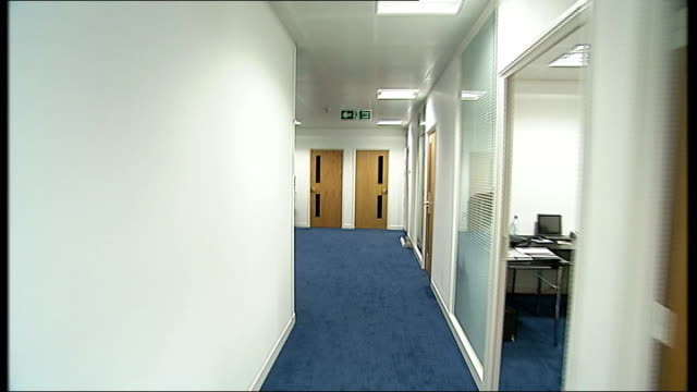 london child exploitation and online protection centre int view through front doors pan and track through reception and along corridors through open... - open plan stock videos and b-roll footage