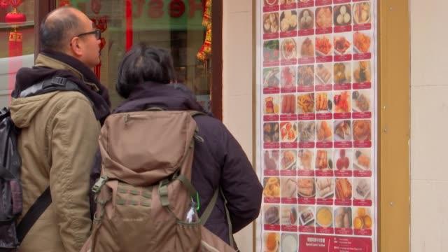 london chinatown ext various red lantern decorations / chinese restaurants / stone gargoyles - chinatown stock videos & royalty-free footage