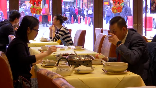 london chinatown int customers eating at tables in yming restaurant - restaurant stock videos & royalty-free footage