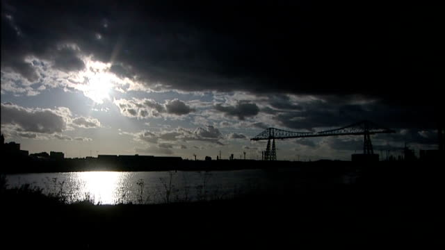 vídeos de stock, filmes e b-roll de gvs cleveland police force headquarters / general views of middlesbrough; dusk transporter bridge in silhouette / general view across river tees,... - tees river