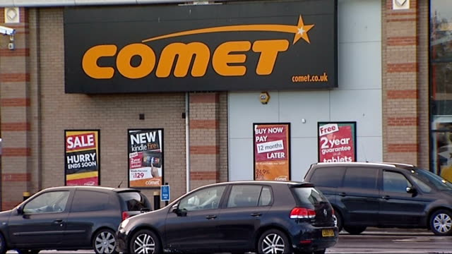 gvs comet store; england: london: new cross: comet: ext comet sign outside store front / gvs comet store and car park in new cross / comet signs /... - comet stock videos & royalty-free footage