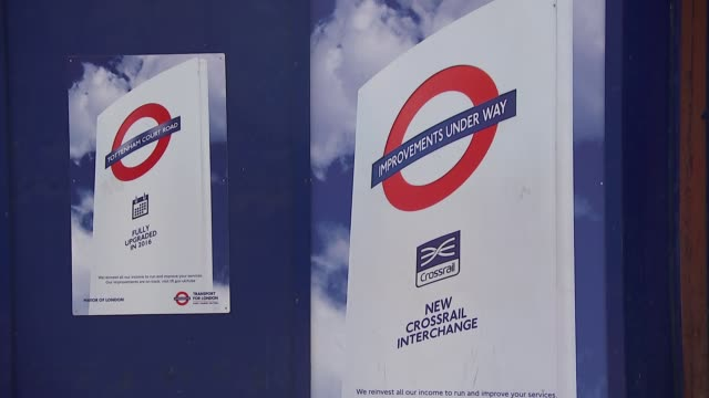 gvs crossrail construction at tottenham court road; england: london: tottenham court road: ext gvs hoarding and crossrail sign as commuters past /... - tottenham court road stock videos & royalty-free footage