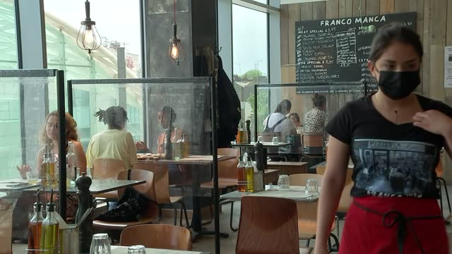 gvs franco manca pizza restaurant; england: london: int gv staff member using till and away gv chef placing pizza in oven gvs chef kneading dough and... - slice stock videos & royalty-free footage