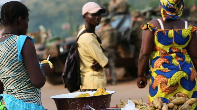 gvs from a displaced persons camp in the central african republic the seleka conflict has raged since 2013 - armored truck stock videos and b-roll footage