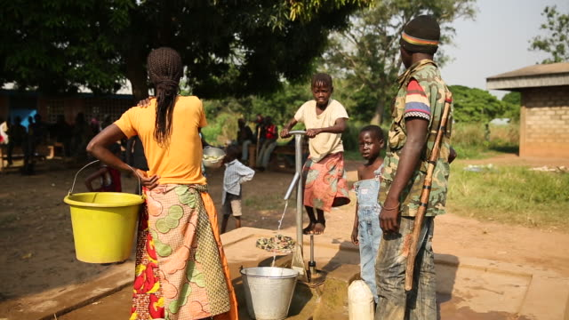 gvs from a displaced persons camp in the central african republic the seleka conflict has raged since 2013 - water pump stock videos & royalty-free footage
