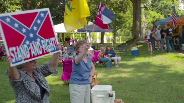 gvs from jackson mississippi where a rally is being held to preserve the confederate flag - confederate flag stock videos and b-roll footage