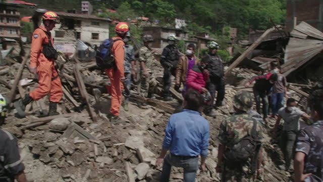 gvs from nepal where the april 2015 earthquake has killed thousands and civilians must deal with the aftermath as rescue teams from around the globe... - rubble stock videos & royalty-free footage