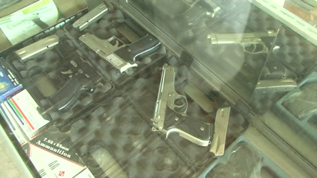 gvs from pakistan where people have been displaced following floods and attacks from the taliban are on the rise causing the gun market to expand - gun shop stock videos & royalty-free footage