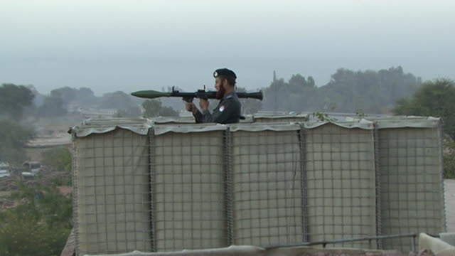 gvs from pakistan where people have been displaced following floods and attacks from the taliban are on the rise causing the gun market to expand - rocket launcher stock videos & royalty-free footage
