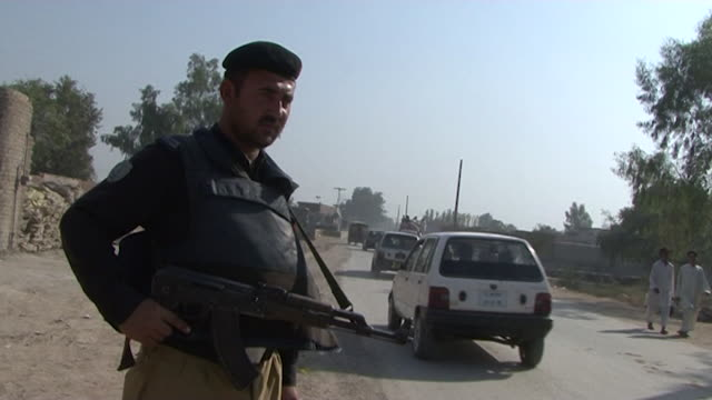 gvs from pakistan where people have been displaced following floods and attacks from the taliban are on the rise causing the gun market to expand - taliban stock videos & royalty-free footage