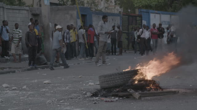 gvs from portauprince haiti where president michel martelly has resigned and thousands of opposition members still protest saying their candidates... - haiti stock-videos und b-roll-filmmaterial