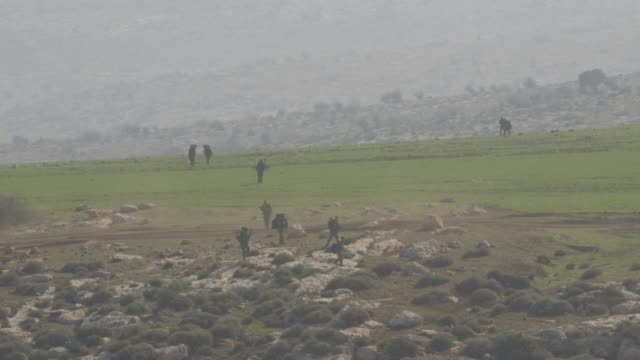 stockvideo's en b-roll-footage met gvs from the jordan valley where the ultraorthodox are required by law to serve the israeli defense forces much to the community's dismay - israëlisch leger