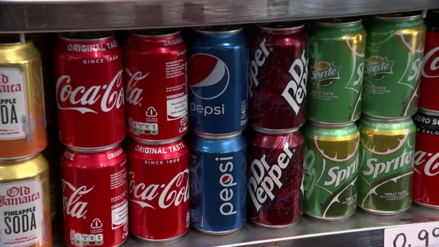 london various soft drinks and healthy fruit drinks in fridge cooler display / cans and bottles / san pellegrino / coca cola / pepsi / dr pepper /... - water cooler stock videos & royalty-free footage