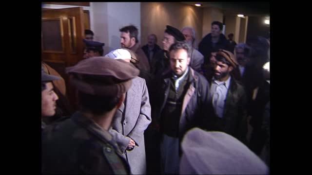 gvs hamid karzai meeting burhannudin rabbani; afghanistan: kabul: intercontinental hotel: int 00:00:00 lms hamid karzai and former afghan president... - intercontinental hotels group stock videos & royalty-free footage