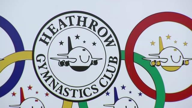 london hounslow ext gvs of heathrow gymnastics club including overground bushes signs heathrow gymnastic club aeroplane logo and plane flying over... - bush stock videos & royalty-free footage