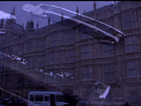 gvs house of lords, superimposed and fade out, slow motion hand lifting up parliament act headed paper - fade out stock videos & royalty-free footage