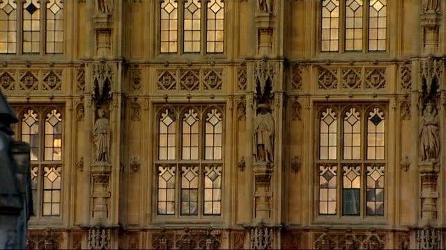 gvs houses of parliament; england: london: houses of parliament: ext / day to dusk low angle gvs of union jack flying on flagpole, houses of... - floodlit stock videos & royalty-free footage