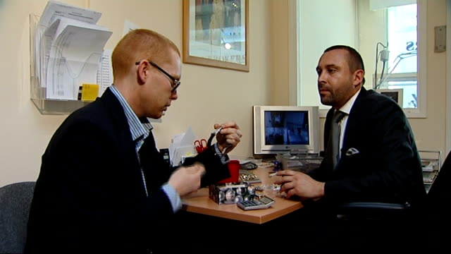 gvs in pawnbroker's shop in city of london pawnbroker's sign various shots of pawnbrokers michael julian and nikolas robinson examining a variety of... - pawnbroker stock videos & royalty-free footage