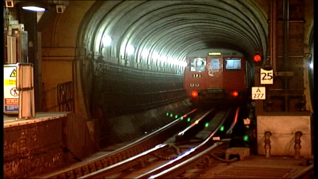 gvs interior of rotherhithe and wapping underground stations and thames tunnel; england: london: wapping int passenger waiting on wapping station as... - rear view stock videos & royalty-free footage