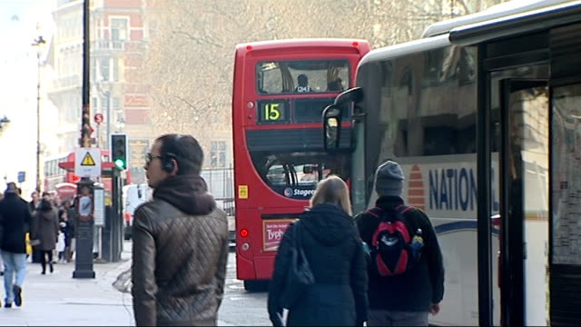 london ext bus stop sign / bv 26 bus along / feet of people at bus stop and legs of people walking along street / bv passengers boarding bus /... - aldwych stock videos and b-roll footage