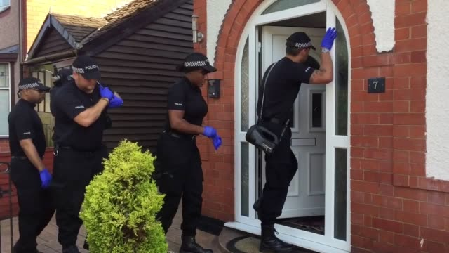 gvs of a police search team and other police staff entering a house in nuneaton warwickshire after an arrest nearby thought to be connected with the... - warwickshire stock videos & royalty-free footage