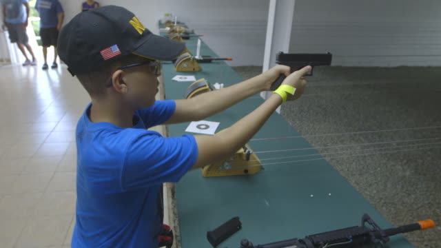 gvs of an nra-hosted target shooting event in puerto rico. - 全米ライフル協会点の映像素材/bロール
