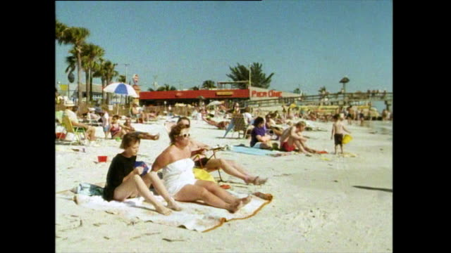 gvs of beach and tourists in florida; 1991. - fort myers beach stock videos & royalty-free footage