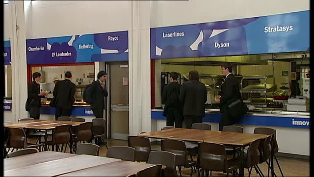 gvs of black country university technical college int various shots of students in canteen / signs with names of engineering companies / students at... - technical college stock videos & royalty-free footage