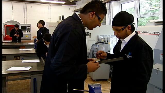 gvs of black country university technical college various shots of students filing metal objects held in vice / student using hacksaw to cut metal... - technical college stock videos & royalty-free footage