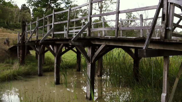 gvs of bridge that inspired the setting for winnie the pooh and his friends to play pooh sticks, restored in field in kent and will be going up for... - literature stock videos & royalty-free footage