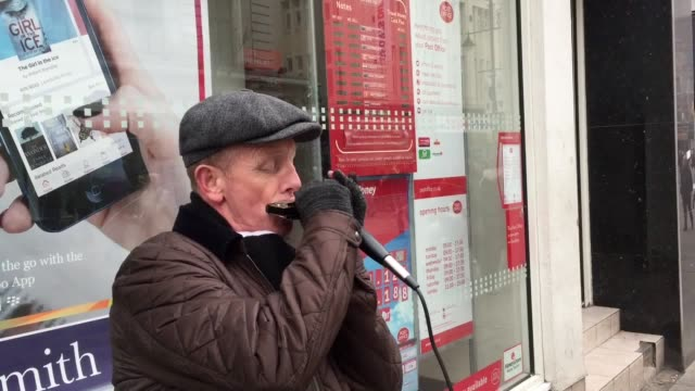 GVs of busker Dave Snowdon playing his chromatic harmonica in Northumberland Street Newcastle which is one of the cities around the country to take...