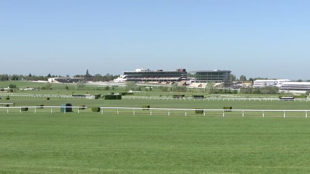 gvs of cheltenham racecourse; england: gloucestershire: cheltenham: ext gvs of an empty cheltenham racecourse including empty track, lawn, stands,... - cheltenham stock videos & royalty-free footage