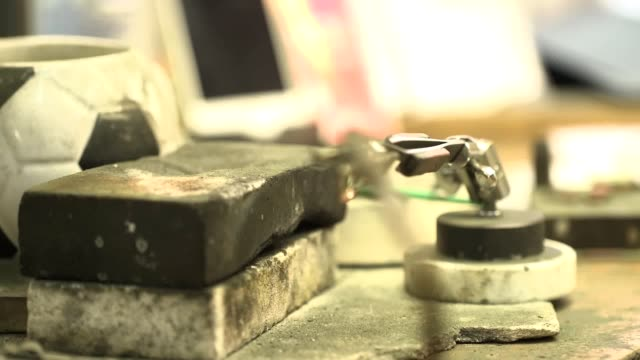 gvs of diamond workshop closeups of rings being manufactured interview with he creative director of 77diamonds david allen cutways of polished... - press release stock videos and b-roll footage