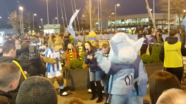 Gvs of fans and mascots outside the Etihad Stadium before Manchester City's FA Cup fifth round replay against Huddersfield Gvs of Manchester City...