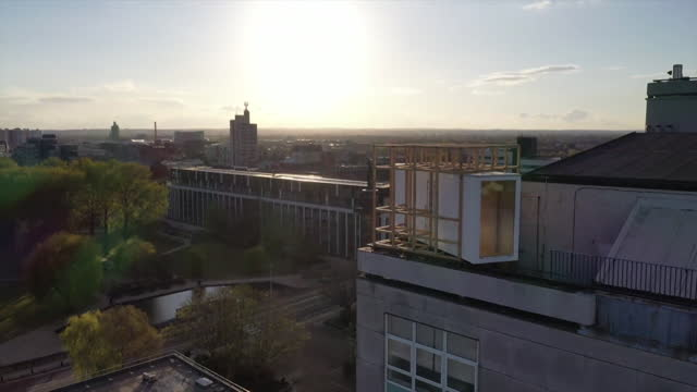 gvs of glass box perched high above hull, that is a year long art project to give people time to reflect on their lives after the coronavirus pandemic - contemplation stock videos & royalty-free footage