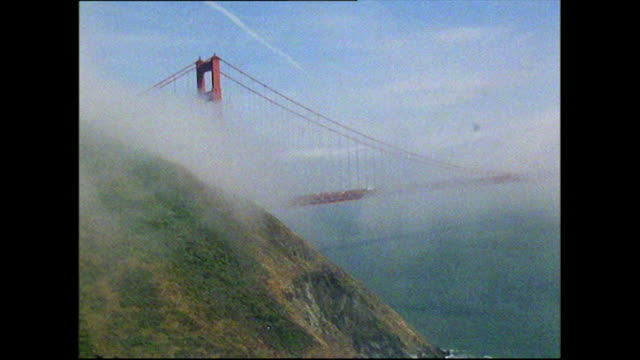 gvs of golden gate bridge surrounded by clouds; 1972 - bbc archive stock-videos und b-roll-filmmaterial