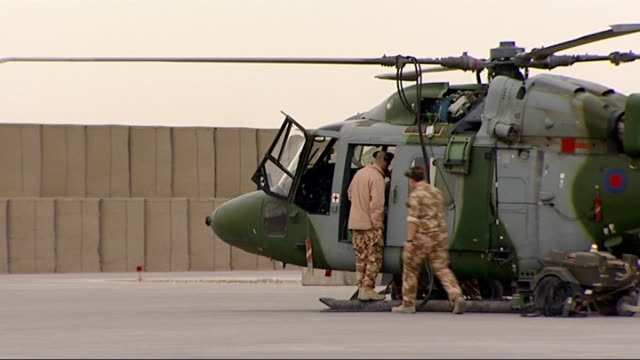 gvs of helicopters at camp bastion afghanistan helmand province camp bastion throughout*** helicopter with rotors turning griffon helicopters on... - helicopter rotors stock videos and b-roll footage