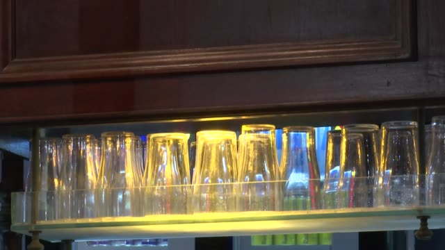 gvs of lgbt clubs in vauxhall; england: london: vauxhall: int mirror ball at the royal vauxhall tavern / empty stools around table / bar with... - bar点の映像素材/bロール
