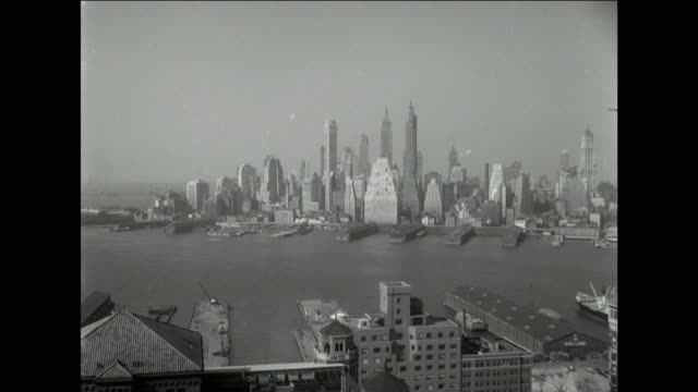 gvs of manhattan over east river from brooklyn - 1950 stock-videos und b-roll-filmmaterial