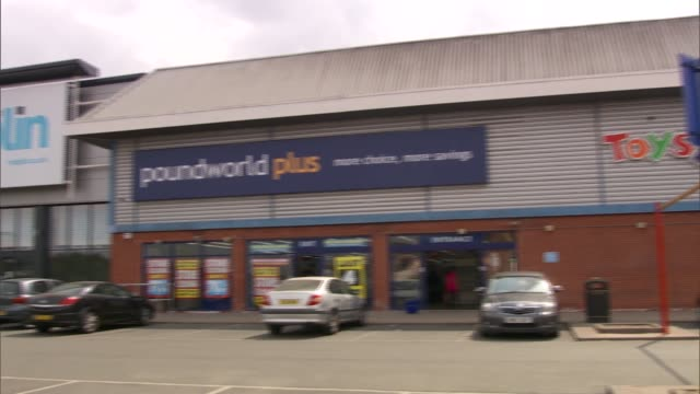 gvs of maplin, toys r us, and poundworld stores; england: leicester: ext gvs maplin, poundworld, toys r us stores / closing down posters / retail... - toys r us stock videos & royalty-free footage